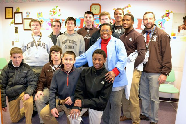 Mount Carmel students, led by Service Club Moderator Mr. Scott Sortal, delivered toys to Dr. Marie Muscadin at St. Bernard Hospital on December 18.