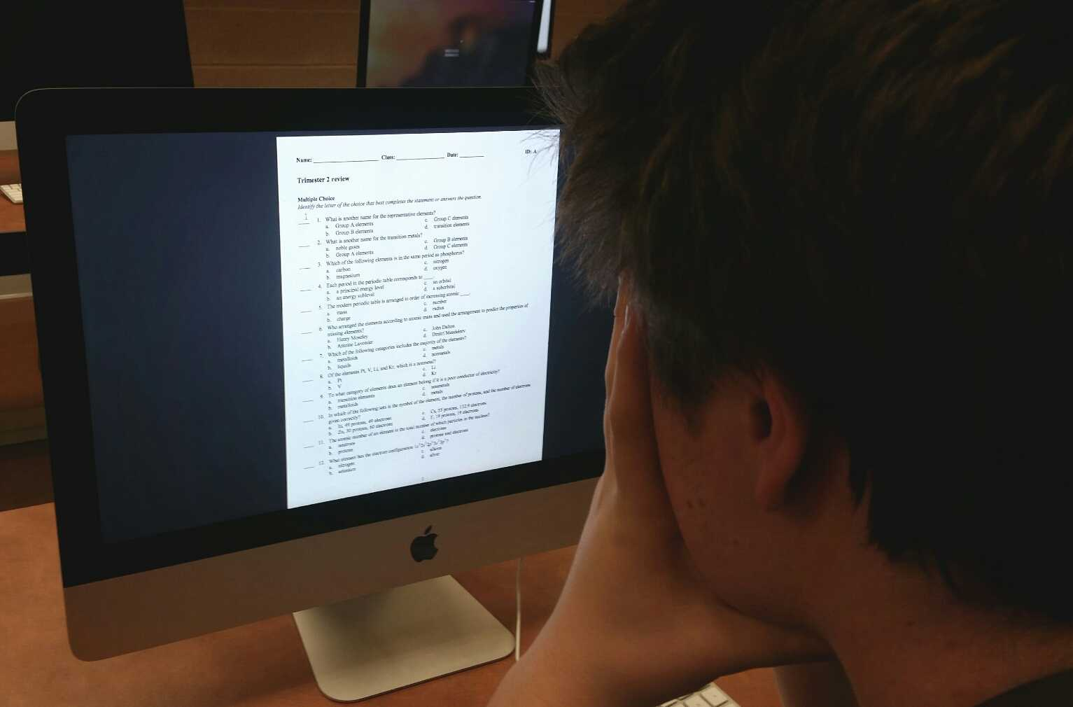 Junior Jack Lockard looks perplexed by Mr. Sobucki's Trimester 2 study guide for Chemistry.