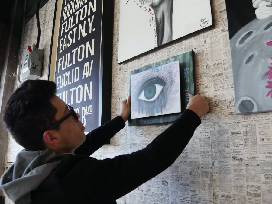Junior Anthony Morales is one of several MC students whose art work is on display at Robust Coffee House.