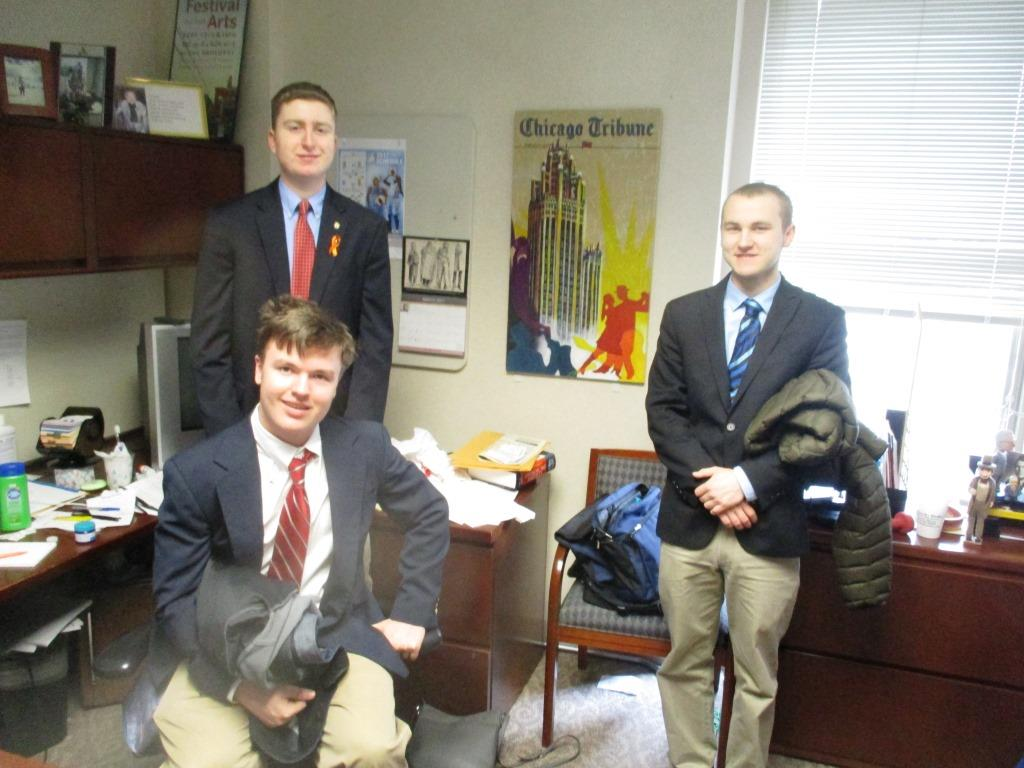 Zack Pasciak (on right) joined fellow Caravan staffers Jack Lockard (seated) and Conor Langs during a visit to the office of Chicago Tribune Standards Editor Margaret Holt.