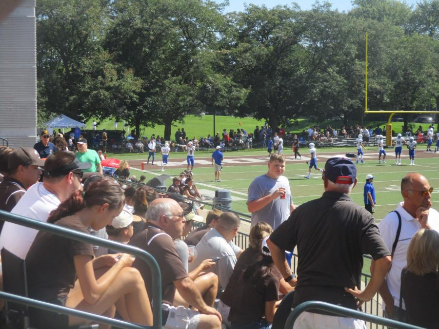 Fans+of+Mount+Carmel+and+DeLaSalle+enjoy+a+Saturday+Caravan+victory+from+the+temporary+bleachers+on+Carey+Field.++%28Photo+credit%3A++George+Vrechek%29