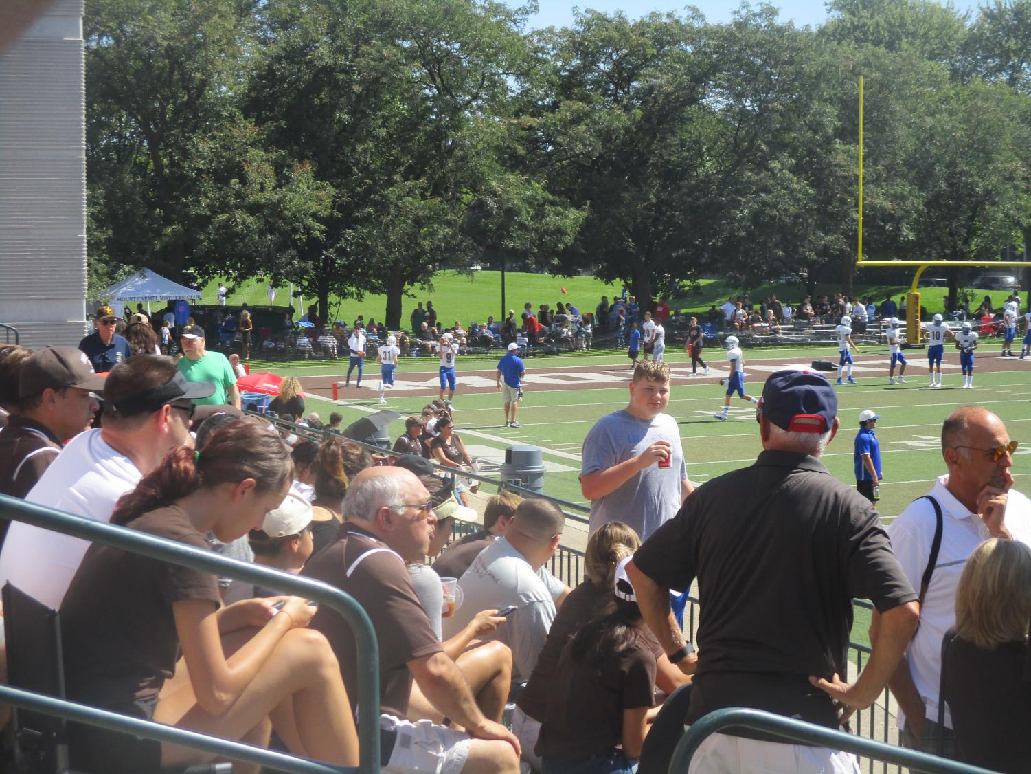 Fans of Mount Carmel and DeLaSalle enjoy a Saturday Caravan victory from the temporary bleachers on Carey Field.  (Photo credit:  George Vrechek)