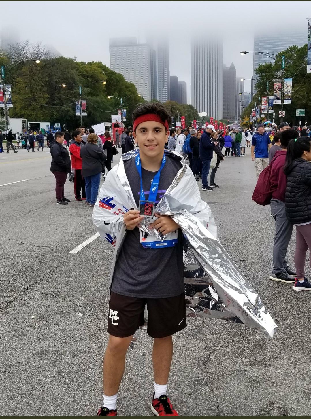 Cristian Sanchez still smiling after running 26.2 miles.