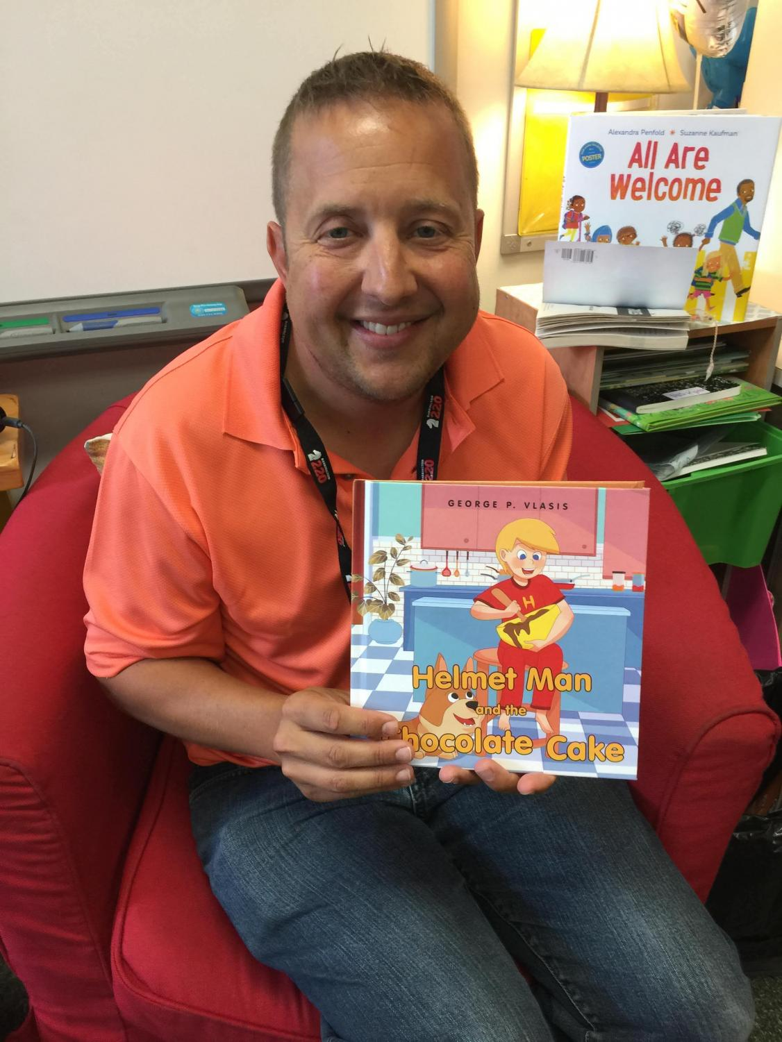 Mr. George Vlasis in the classroom with his newly published book