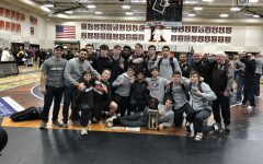 Varsity wrestling slices through competition at Cheesehead