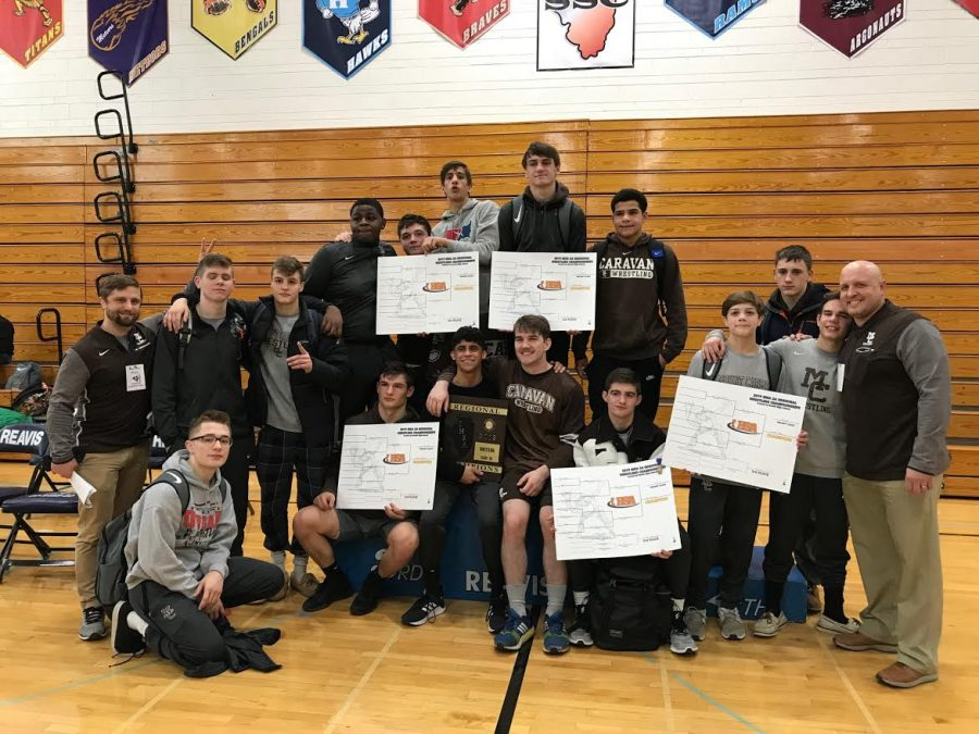 The+varsity+wrestling+team+took+first+place+at+the+IHSA+Regional+tournament+at+Reavis+High+School+on+February+2.
