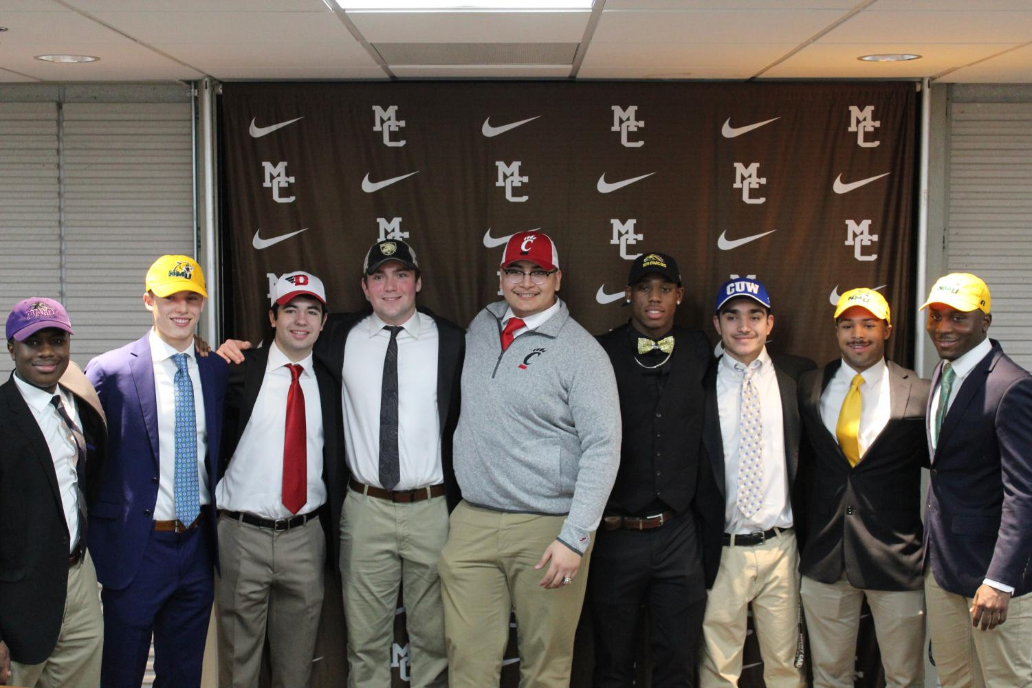 Nine MC seniors signed college letters of intent on February 6.  (left to right: Abdel Raoul, Radomir Premovic, Matthew Lenti, Patrick Szczesniak, Marcelo Mendiola, Kyle Davis, David Lopez, Eddie McGee, and Davion Brooks