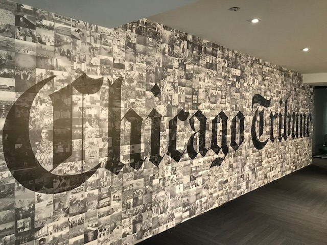 A+mural+in+the+Tribune+offices+is+made+up+of+individual+photos+from+the+Tribune+archives.+%28photo+credit%3A++Matt+Martinez%29