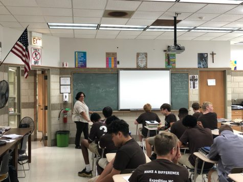 Mrs. Emma Norise, pictured in her 2019 Chemistry class, is the moderator of the Medical Enrichment Club.