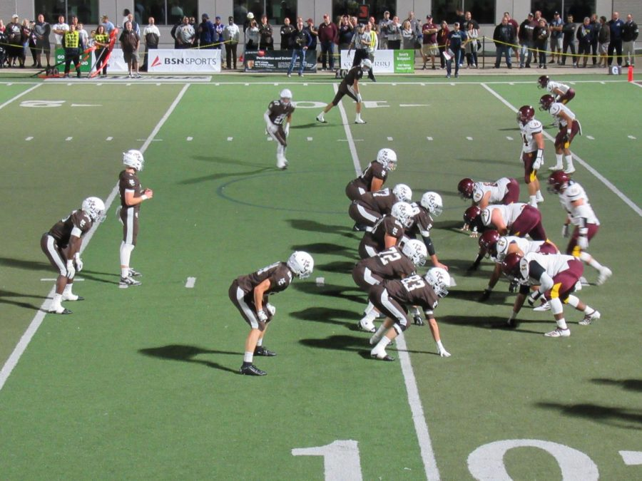 Quarterback+Justin+Lynch+gets+set+for+the+first+set+of+downs+at+the+newly+dedicated+Barda-Dowling+Stadium+at+Carey+Field.