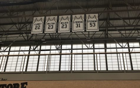Who are the men behind those five retired jerseys?