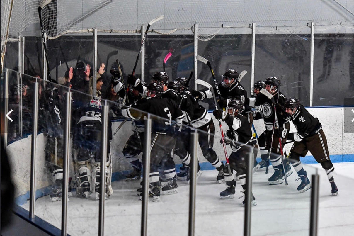 The Caravan hockey team celebrates with their fans with a victory