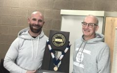 Varsity Football coach Jordan Lynch and athletic director Dan LaCount were all smiles as they celebrated Mount Carmel state championship on December 6, 2019.