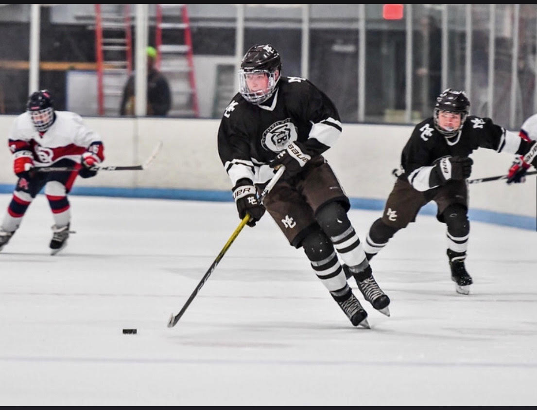 Junior Forward Duke Allen #23 is on a breakaway with the puck