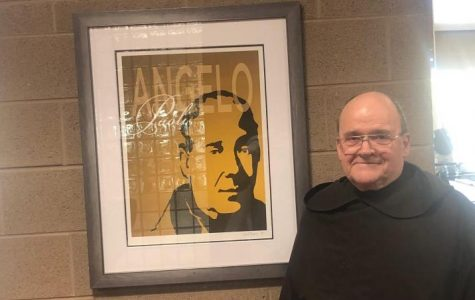 Fr. Leopold standing next to his favorite Carmelite out of all of the paintings