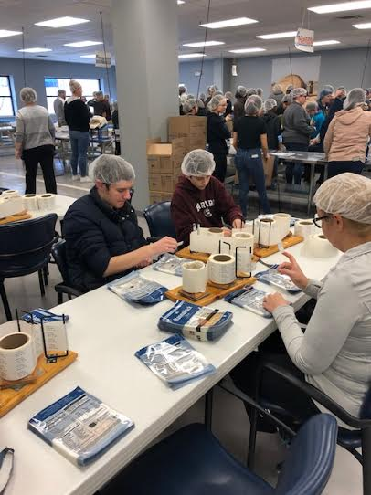 At the end of the day at Feed My Starving Children, one group of MC students had packed 194 boxes of food for developing nations.