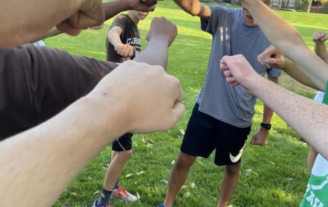 Coach Burke and the Cross country put their hands in after practice on 9/25/20