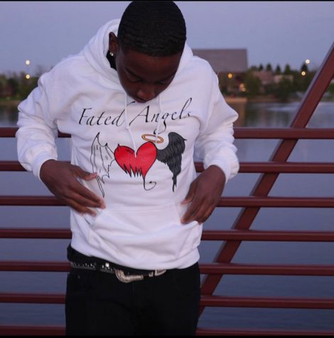 "Kendrick rocks one of his custom hoodies from his ""Fated Angels"" brand"