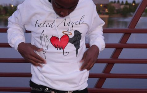 """Kendrick rocks one of his custom hoodies from his """"Fated Angels"""" brand"""