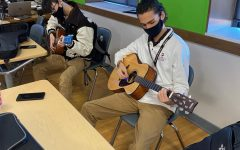 Seniors Ethan Hansen and Holden Shamala practice for their presentation exam in guitar class.