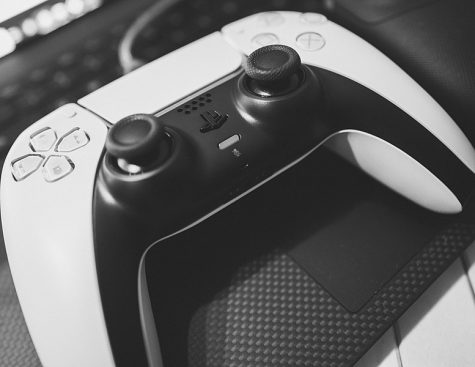 The Playstation Duelsense controller is one of many options consumers debate when comparing Xbox and PS5.  (Photo credit:  Sergey Galyonkin via Wikimedia Commons under Creative Commons license.