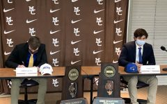 Connor Gaynor, left, and Thomas Egan, right, on signing day at Mount Carmel, October 11.