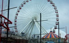 Navy Pier, with its massive ferris wheel,  is one of many local attractions that must await the end of COVID-19 restrictions.  (Photo credit:  E. Kvelland via Wikimedia Commons under Creative Commons license.)