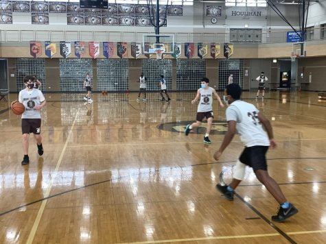 Mount Carmel basketball players wear masks while practicing and during games.