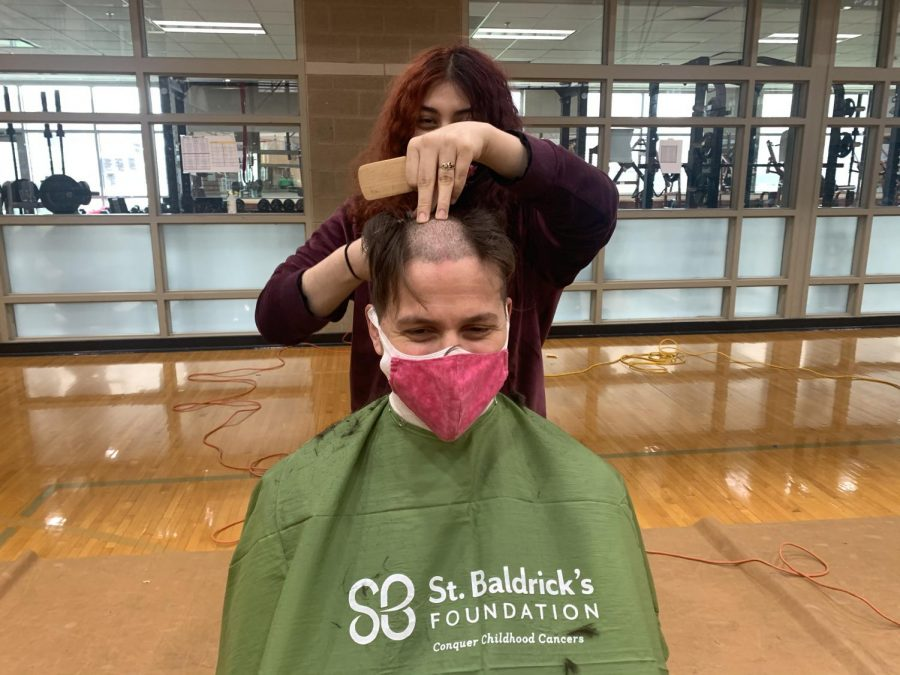 Mr. Brooks Nevrly getting his hair cut for his 3rd St. Baldrick's Day