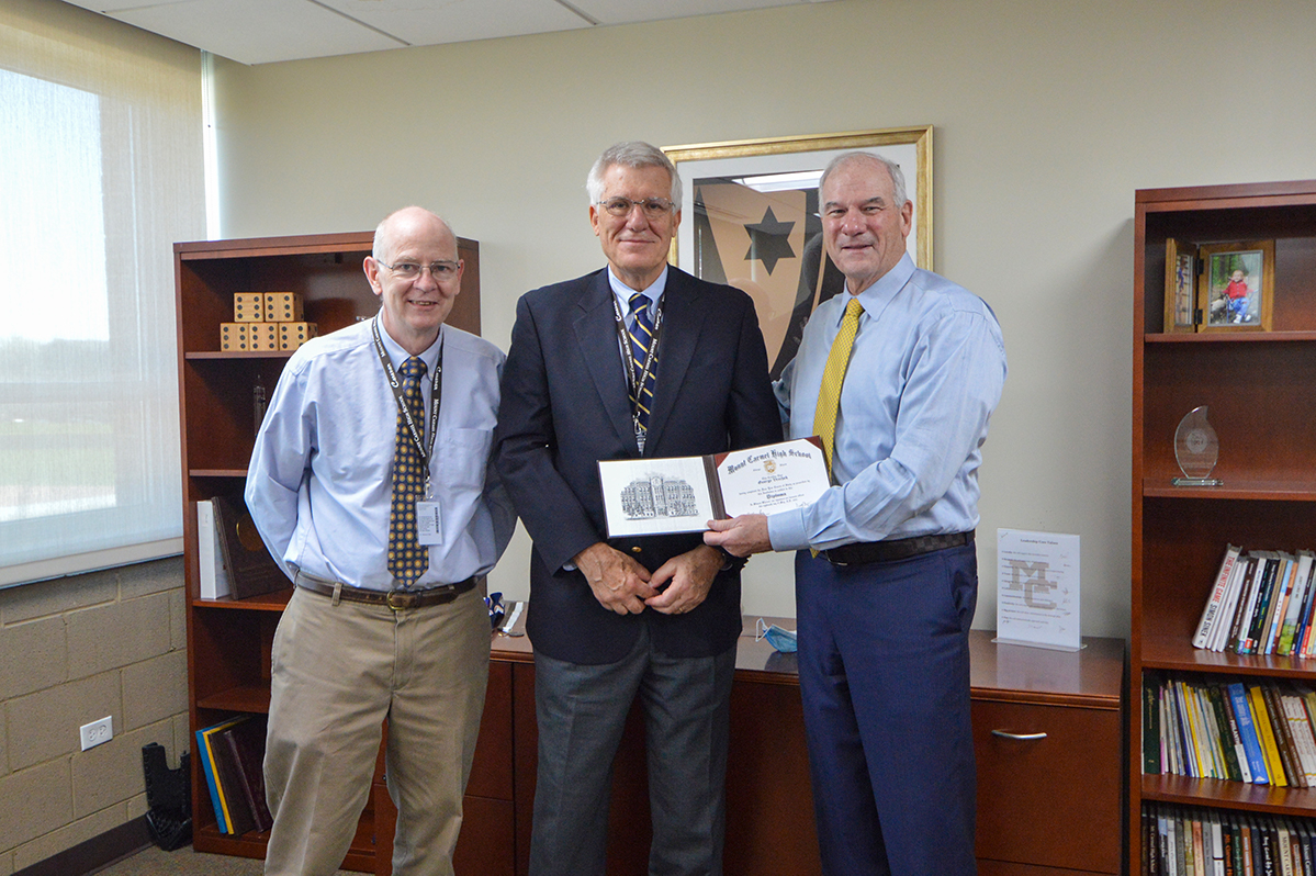Upon his retirement from his volunteer role, George Vrechek (pictured with Journalism teacher John Haggerty and President Ned Hughes) was named an Honorary Alumnus of Mount Carmel High School.
