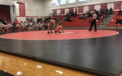 Returning State Champion Noah Mis wrestling his Marist Opponent