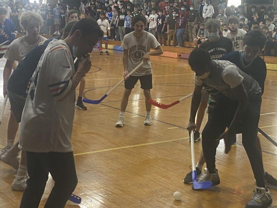 Students battle in the Homecoming Week floor hockey game.
