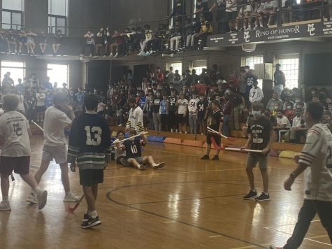 Students celebrate a goal in the Homecoming Week floor hockey game.